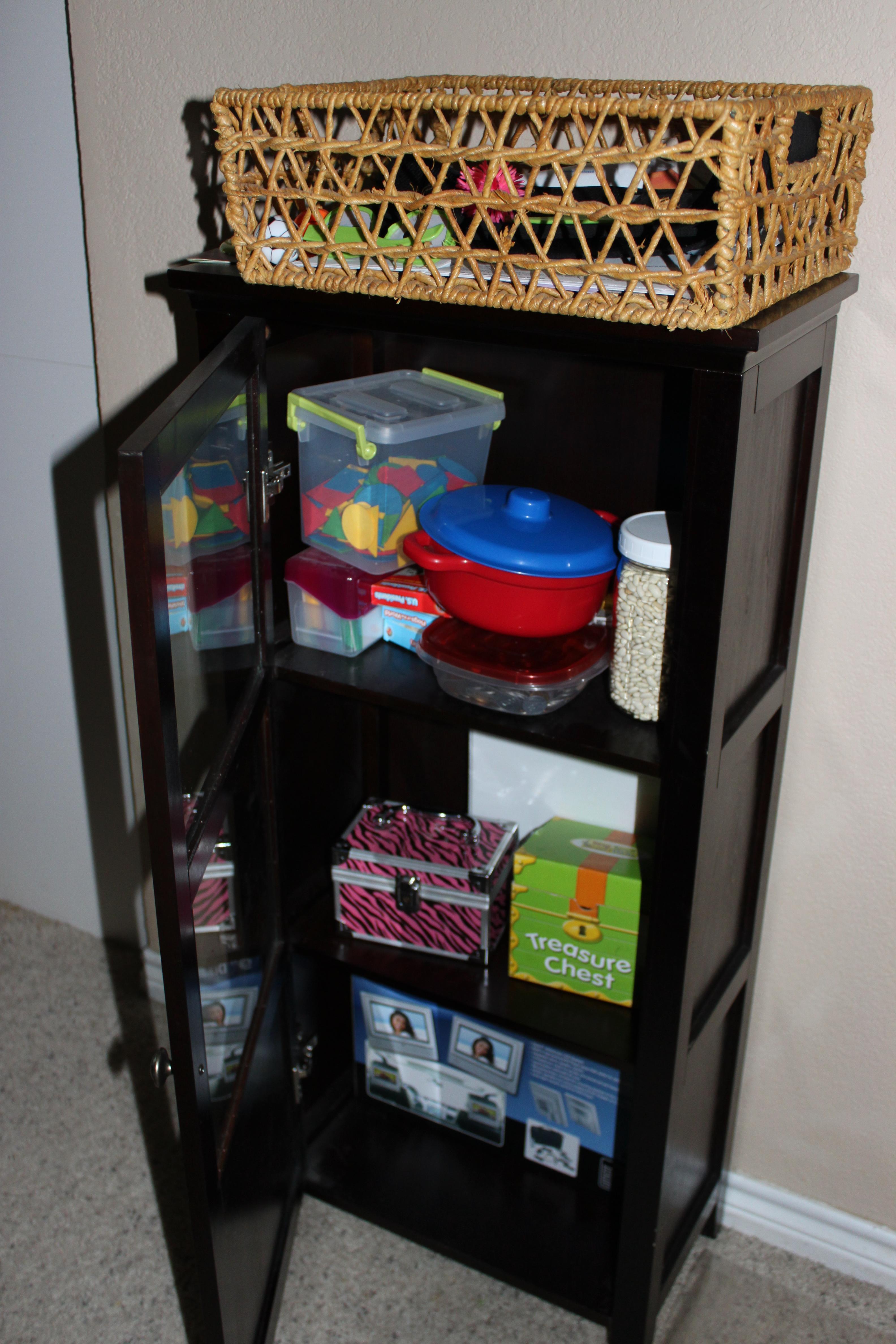 Random cabinet stuffed with school paraphernalia